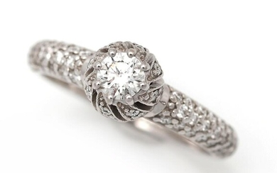 A diamond ring set with a brilliant-cut diamond weighing app. 0.35 ct. encircled by numerous diamonds, mounted in 18k white gold. Size 57.5. – Bruun Rasmussen Auctioneers of Fine Art