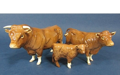 A family of three Beswick Limousin cattle comprising bull, c...