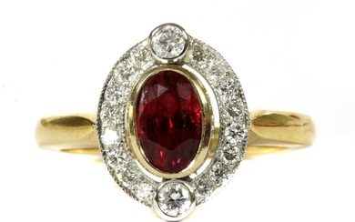A gold red spinel and diamond cluster ring