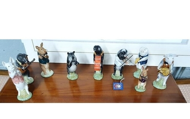 A group of nine Beswick musical Pigs.