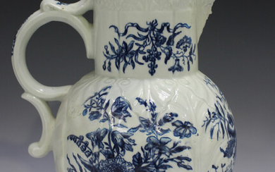 A large Worcester blue painted jug, circa 1770-85, decorated with the Pine Cone Group pattern over a