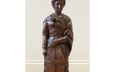 A late 19th century carved oak figure of St George, after Do...
