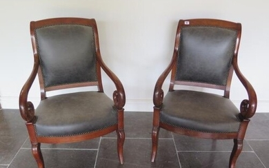A pair of 19th French mahogany fauteuils scroll arm open arm...