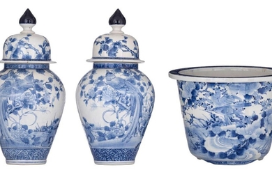 A pair of Japanese blue and white Arita covered vases and a ditto jardinière, Meiji period, H vases 50,5 cm