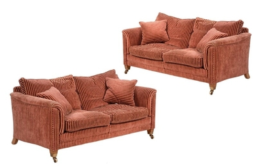 A pair of walnut and red and gold striped sofas