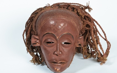 African dance mask carved in patinated wood, red...