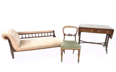 An Edwardian chaise longue, upholstered in salmon pink, back...