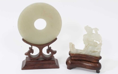 Good Chinese carved jade figure, together with a carved jade bi-disc