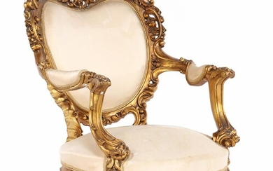 (-), Classic gold-colored armchair with rich stitching, former...