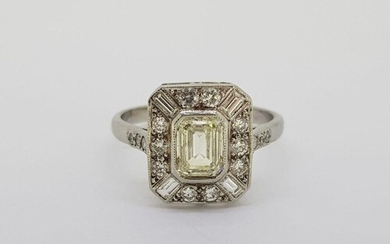 Platinum tablet ring with a central Emerald cut diamond of a...