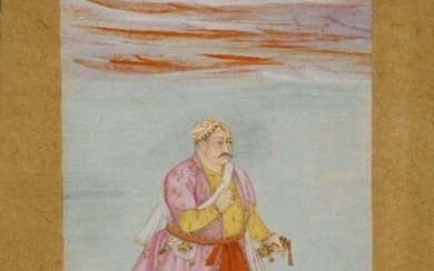 Raja Udai Singh (Mota Raja) of Marwar, Rajasthan, North India, early 19th century, opaque and transparent pigments heightened with gold on paper, standing facing right, wearing a pink jama, a jewelled turban, he stands on on grassy ground, small...