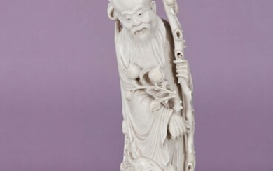 Two ivory subjects > representing Shoulao holding a branch with...