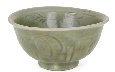 A Chinese grey stoneware Longquan celadon bowl, Ming dynasty, 15th century, incised with stylised floral motifs, red burnished firing ring to base, 15cm diameter
