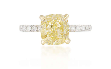A FANCY-COLOURED DIAMOND AND DIAMOND RING The cushion-shaped...