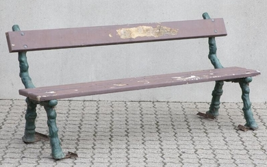 NOT SOLD. A French garden bench with green-painted cast iron gables and painted wooden lamellae. Early 20th century. L. 180 cm. – Bruun Rasmussen Auctioneers of Fine Art