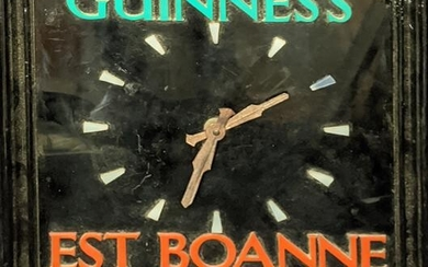 A Guinness wall clock by Smiths, Channel Island French
