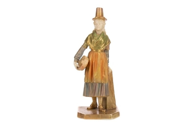A ROYAL WORCESTER FIGURE OF A WELSH GIRL