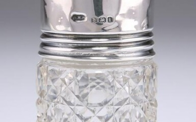 AN EDWARDIAN SILVER-TOPPED GLASS SCENT BOTTLE, by
