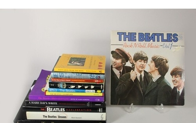 A collection of 11 The Beatles books and a vinyl LP/33 recor...