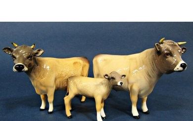 A family of three Beswick Jersey cattle comprising bull, cow...