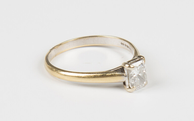 A gold and diamond single stone ring, claw set with a rectangular cut diamond, detailed '18K