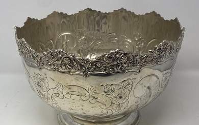 A silver plated punch bowl, with floral decoration, 31 cm di...