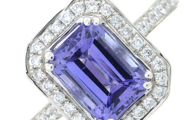 An 18ct gold tanzanite and diamond cluster ring, with diamond line shoulders.