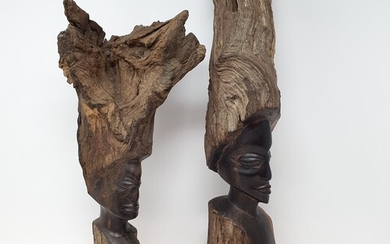 An African ebony carving of a woman, 59 cm high, and another...