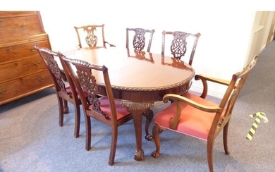 An early 20th century extending oval mahogany dining table h...