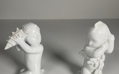 Porcelain figurines from the manufactory Bing & Grøndahl, sea children with bladderwrack and shell.