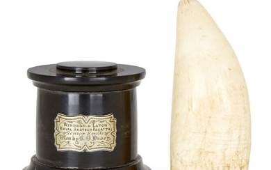 Property of a Gentleman A scrimshaw whale's tooth, early 19th century, finely incised to each side with a two-masted vessel, 15cm high, and a slate socle trophy base with plaque inscribed Windsor & Eaton Royal Amateur Regatta Senior Sculls Won By...