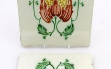 Two tiles decorated with stylised tulip / flower