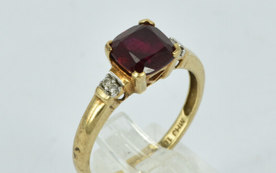 A 10CT GOLD, RUBY AND DIAMOND RING