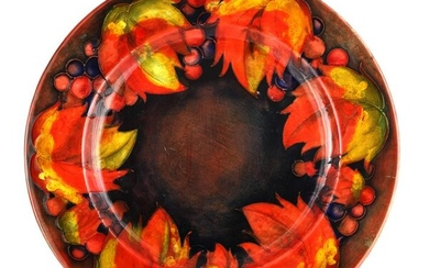 A 1930S MOORCROFT AUTUMN LEAF AND BERRY PATTERN FL