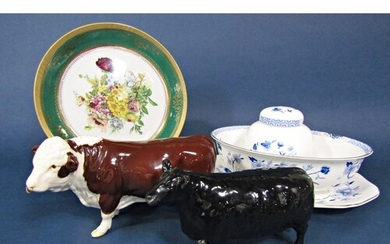 A Beswick Aberdeen Angus cow together with a Beswick Herefor...