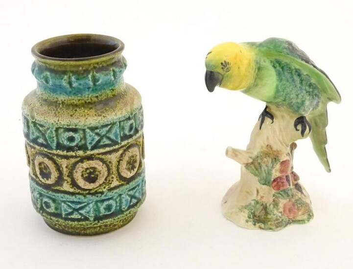 A Beswick model of a parrot, no. 930. Together with a