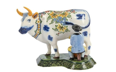 A DUTCH DELFT POTTERY FIGURE OF A MAN AND A COW, 20TH CENTURY