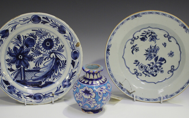 A Dutch Delft plate, 19th century, blue painted with flowers, diameter 22.5cm, together with an Engl
