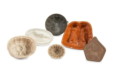 A Group of Ceramic and Copper Jello Molds