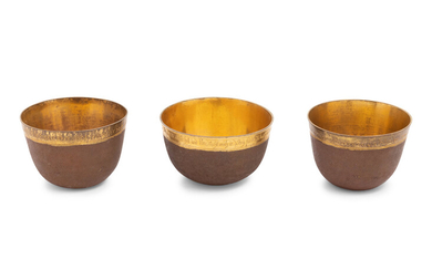 A Group of Three Continental Gilt Metal Herrengrund Cups
