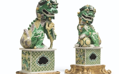 A PAIR OF CHINESE FAMILLE VERTE BISCUIT BUDDHIST LIONS