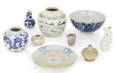 A collection of Chinese and Annamese ceramics, 15th - 19th century, comprising a lobed jarlet, 6cm diameter, two blue and white jars, 9 and 12cm high, a bowl, 17cm diameter, a white glazed figure of a dog, a celadon jarlet, a grey pottery head, and...