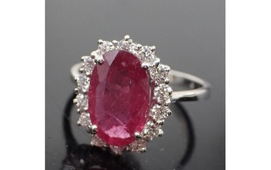 A diamond and ruby cluster ring, total estimated weight of r...