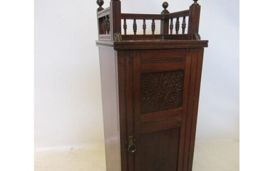 A late Victorian mahogany gallery top bedside locker. Overal...