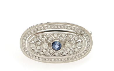 A sapphire and diamond brooch set with a circular-cut sapphire encircled by numerous diamonds, mounted...