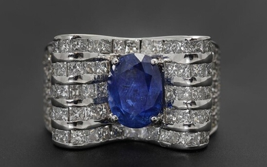 NOT SOLD. A sapphire and diamond ring set with a sapphire weighing app. 5.00 ct. encirceld by diamonds, mounted in 18k white gold. Size app. 57. – Bruun Rasmussen Auctioneers of Fine Art