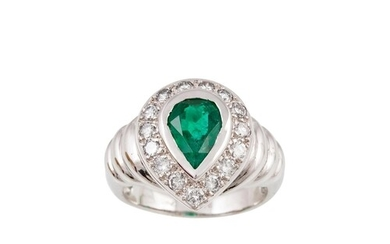 AN EMERALD AND DIAMOND CLUSTER RING, the pear shaped emerald...