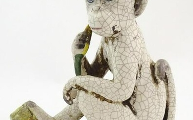 An Oriental style model of a monkey with a banana