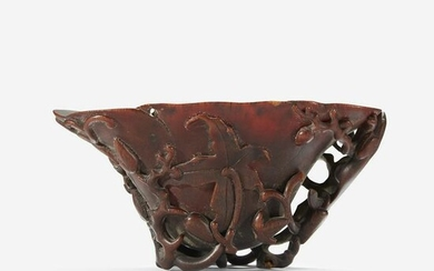 A Chinese Carved Rhinoceros Horn Libation Cup