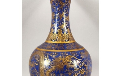 A CHINESE BLUE GROUND BULBOUS VASE, decorated with dragons a...